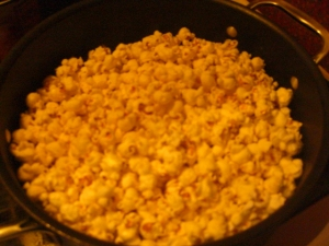 The popcorn's very white in real life. Must be the butter filter.